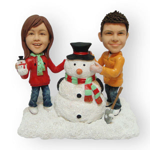 Building A Snowman Couples Figurine