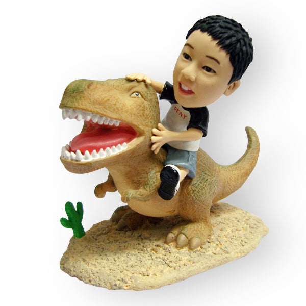 Child Riding A Dinosaur Figurine