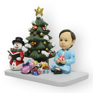 Boy Sitting At Christmas Tree Figurine