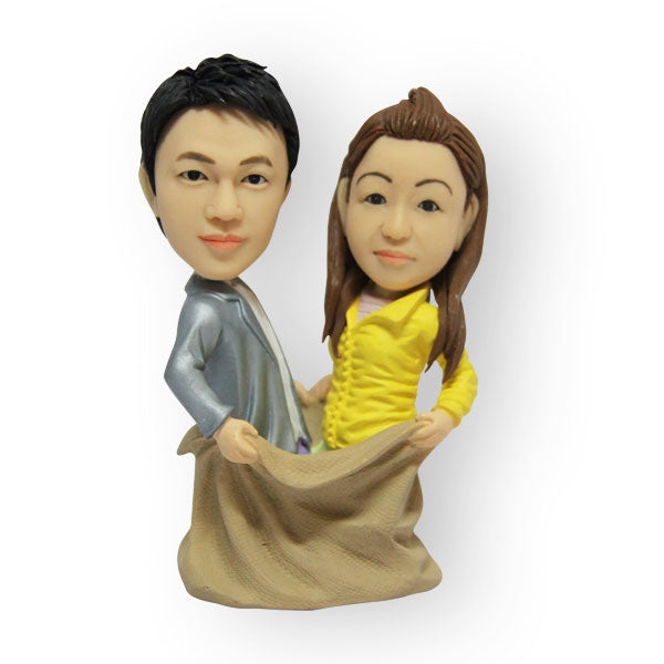 Couple In A Bag Figurine