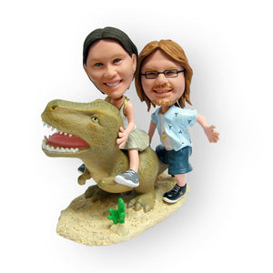 Couple On A Dinosaur Figurine