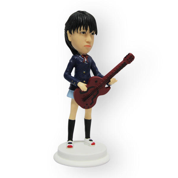 Female Guitar Player Figurine