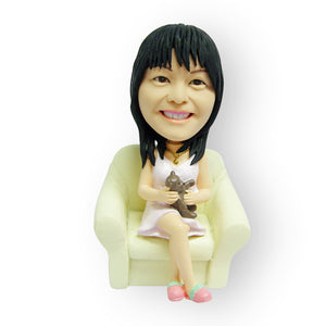 Sitting On The Sofa Figurine