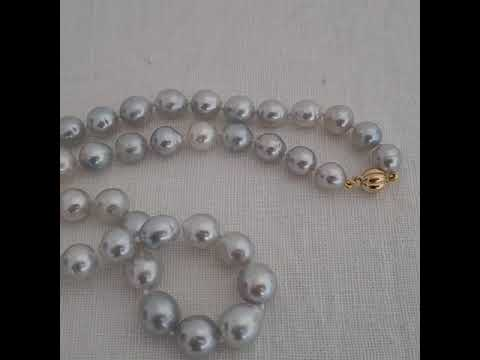 Load and play video in Gallery viewer, South Sea Pearls 9-12 mm Very High Natural Luster, and Silver Color