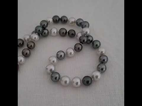 Load and play video in Gallery viewer, South Sea Pearls AAA 9-10 mm white and black color, 18 Karat Gold