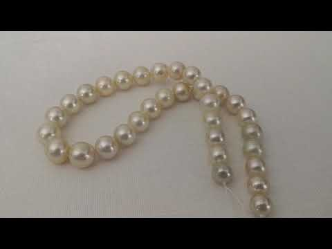 Load and play video in Gallery viewer, South Sea Pearl Strand 10-13,80 mm Round Natural Color & Luster