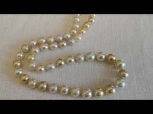 Load and play video in Gallery viewer, Elegant Combination of Natural Color South Sea Pearls 8-11 mm 18 Karat Gold