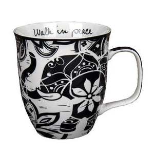 Black & white mug with elephant and floral design. Walk in Peace quote visible inside cup
