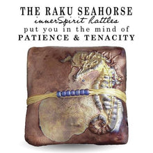 Load image into Gallery viewer, Seahorses are not good swimmers and can die of exhaustion. To prevent being washed away they anchor themselves to coral or sea grass with their tails. The Seahorse innerSpirit Rattle is a symbol of determination.