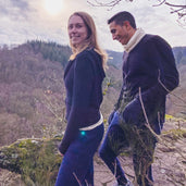 Man and woman hiking in alpaca wool clothes
