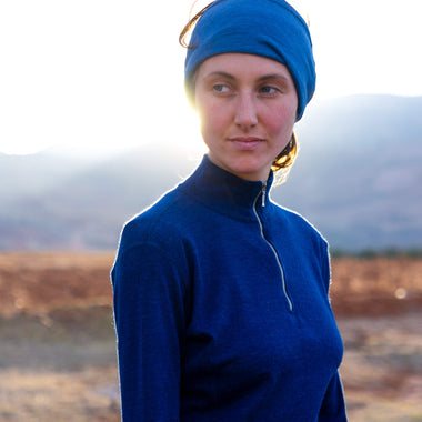 Woman in alpaca wool base layer in natural blue