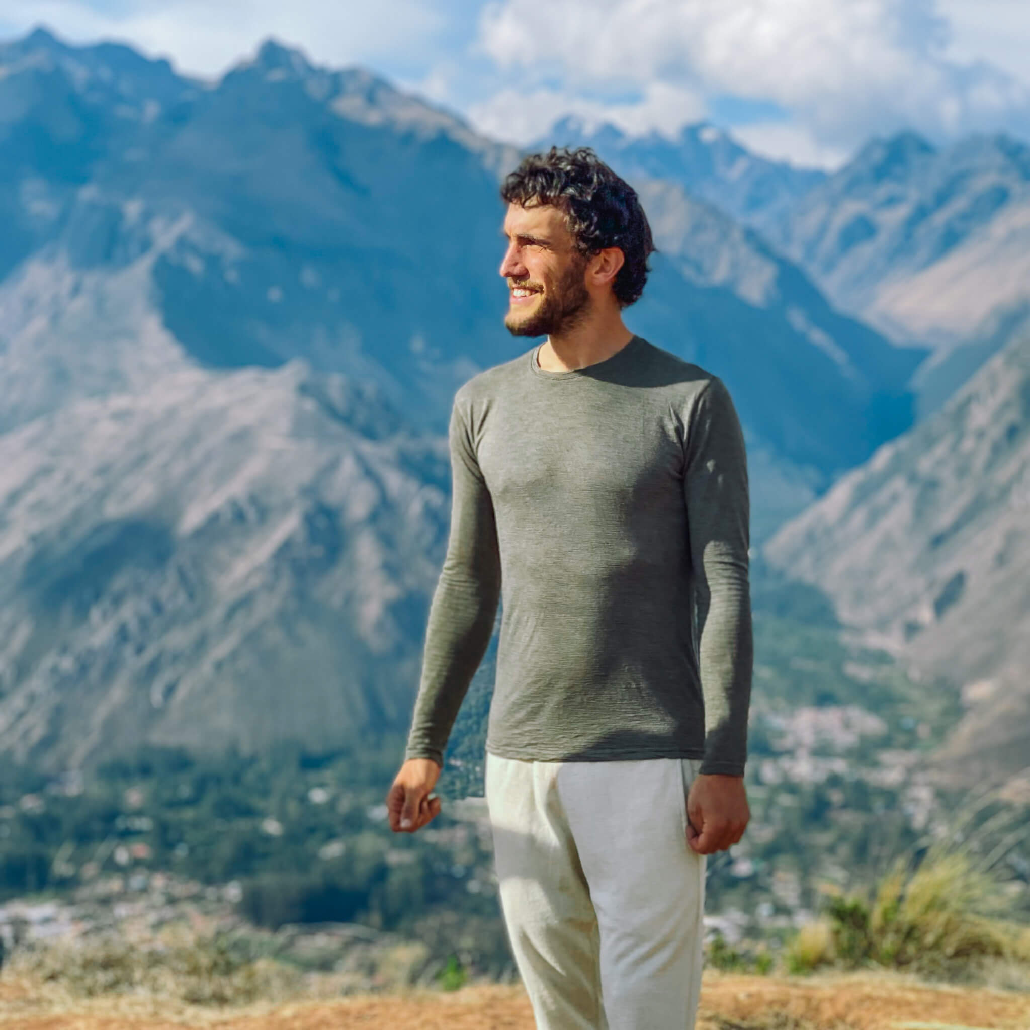 Man wearing alpaca wool long sleeve and joggers in the mountains.