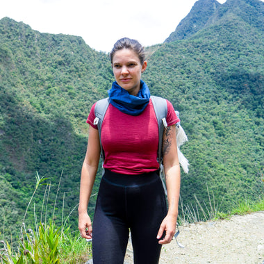 woman hiking in the mountains wearing crew neck t-shirt in cochineal red