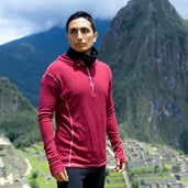 Man in front of Machu Picchu wearing alpaca wool clothes