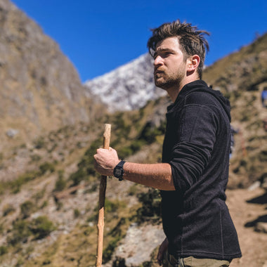 Men with a stick hiking in the mountains in Arms of Andes Alpaca Wool Hoodie Full Zip Hoodie