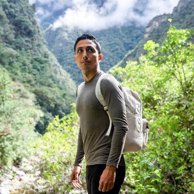 Arms of Andes Man wears White 100% Royal Alpaca Wool Shirt in nature