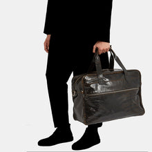 Luxury leather sustainable silk duffle luggage carry-on carryall