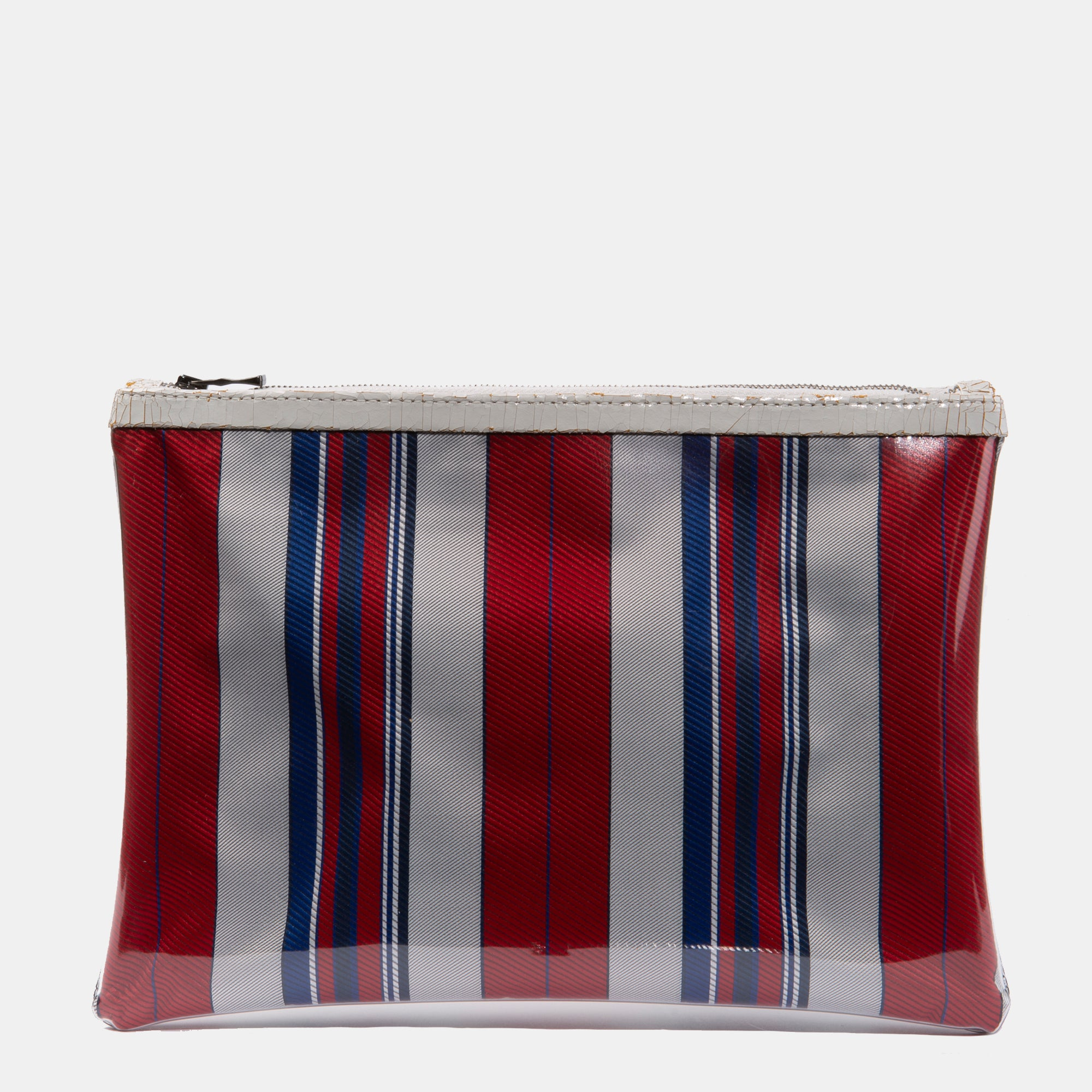 Luxury leather sustainable silk rectangular pouch encased in ecofriendly polyurethane.