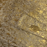 Brazilian Gold Metallic Acid Wash on Brown and White Cowhide