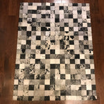 "Brazilian Black and White Patchwork Cowhide Rug 6'8""L x 5'1""W"