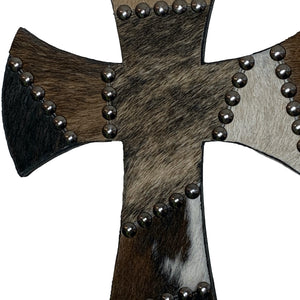 "12"" wood cross covered in brown and grey cowhide patchwork"