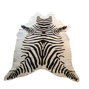 "This Brazilian cowhide is off-white with a chocolate zebra stencil.  6'11"" L x 5'4"" W"