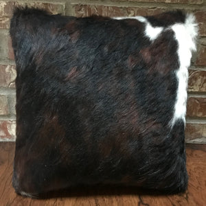"This 16"" x 16"" pillow is dark tri-color cowhide on one side and brown leather on the other side."