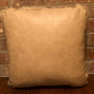 "This 16"" x 16"" pillow is tan cowhide on one side and two-tone tan leather on the other side."