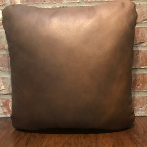 Brown leather side of the medium brindle cowhide pillow