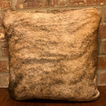 "This 16"" x 16"" pillow is medium brindle cowhide on one side and two-tone brown leather on the other side."