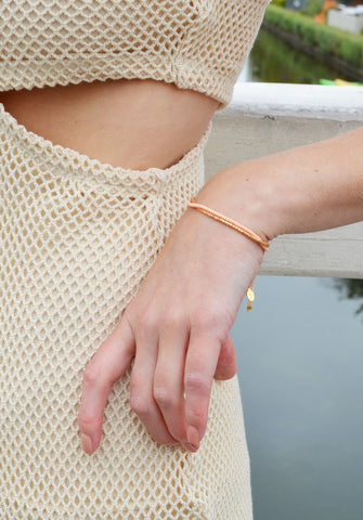 thread bracelet - peachy keen