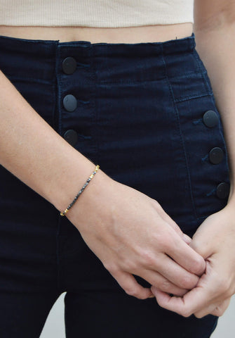thread bracelet - jet gold black