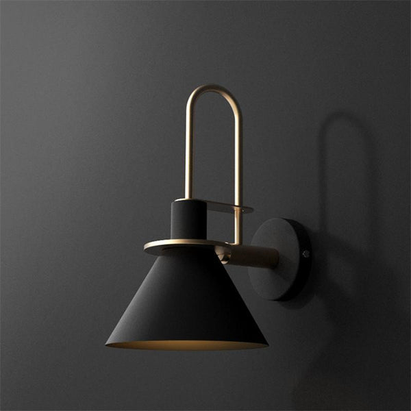 Nordic fancy wall lights of black color with golden brass. Wall light sconces and fixtures