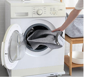 bathroom laundry basket towel shoes gloves clothes magazine