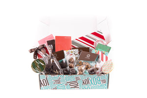 A large joy box, filled with an assortment of sweet JACEK products.