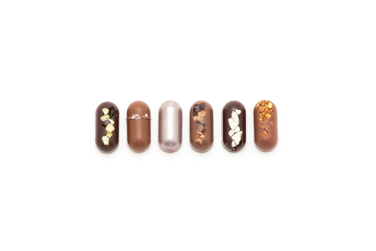 The Petite Bar Collection features six classic flavours from our Artisan Bars, in bite size! These solid chocolates are cast in an oblong shape.