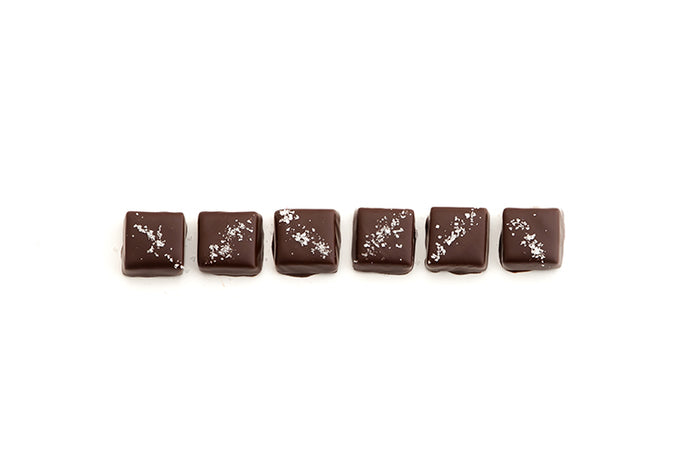 The Salted Caramel Collection is 6 salted caramels, enrobed in dark chocolate and topped with the finest fleur de sel.