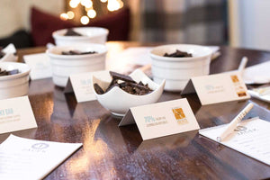 Table cards pictured with bowls of dark chocolate on a table.