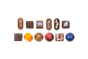 "12-piece collection featuring one solid milk chocolate with the words ""Thinking of You"" on it. The text is white, and is placed inside an illustration of a speech bubble."