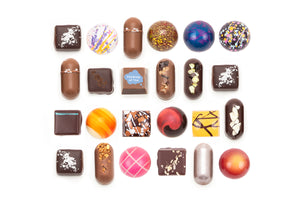 "24-piece collection featuring one solid milk chocolate with the words ""Thinking of You"" on it. The text is white, and is placed inside an illustration of a speech bubble."