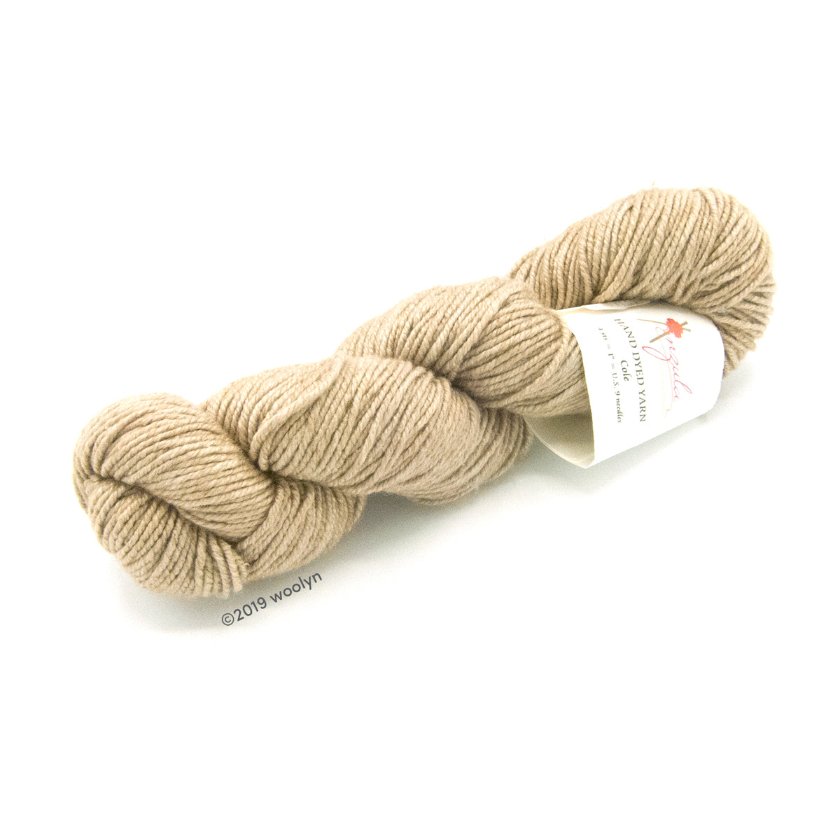 Twisted skein of Anzula Cole yarn in a neutral cream color.