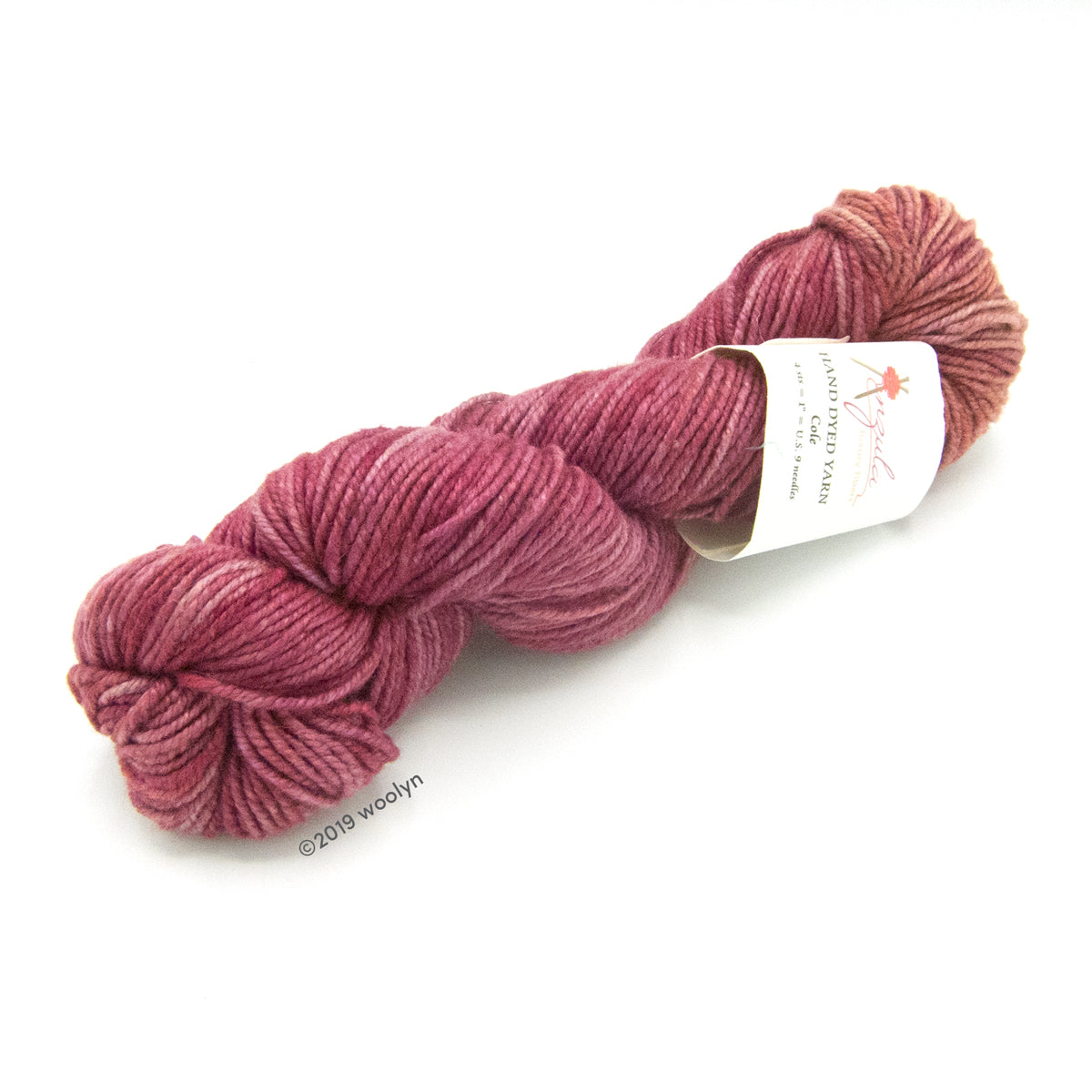 A twisted skein of Anzula Cole in a washed raspberry.