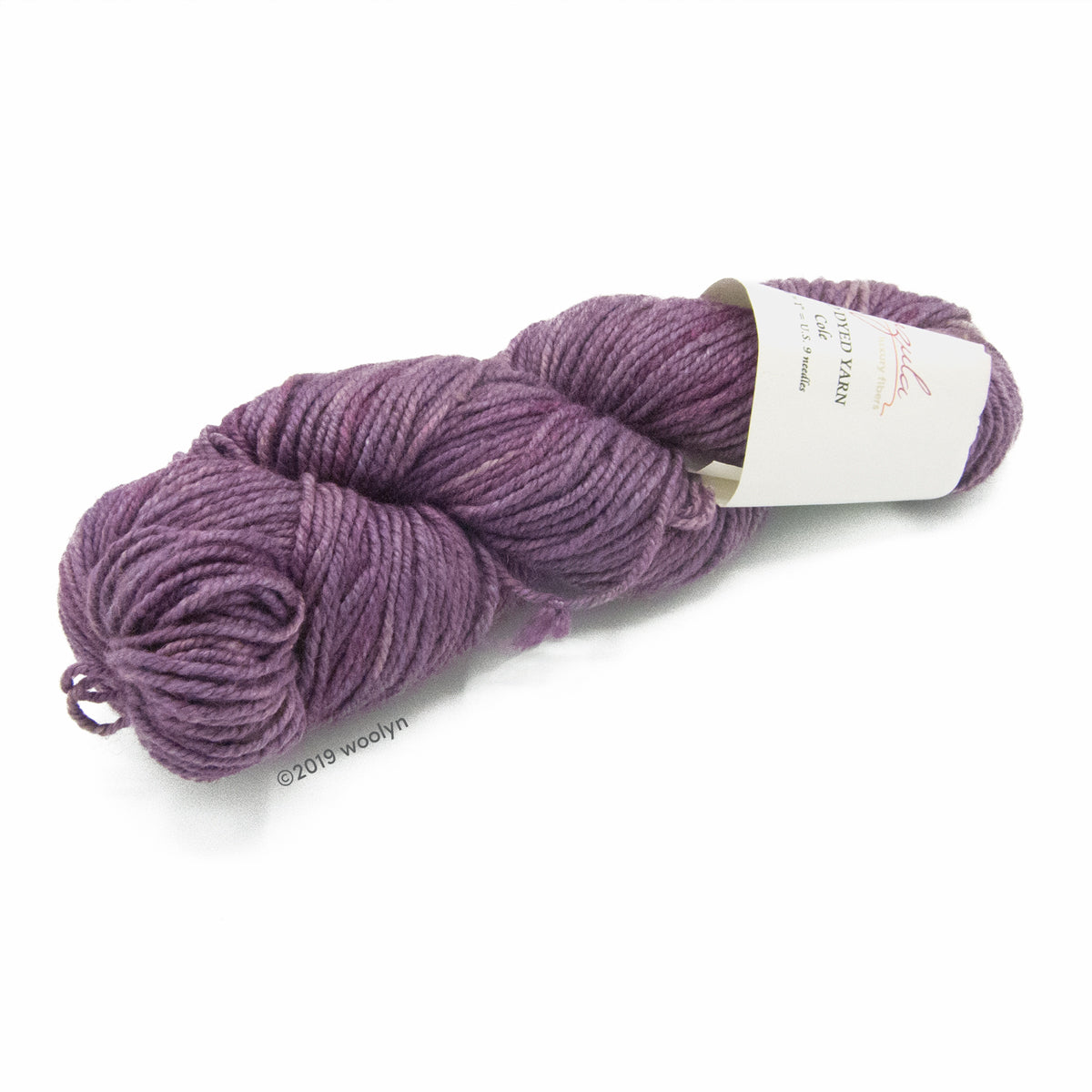 A twisted skein of Anzula Cole yarn in a dark purple.