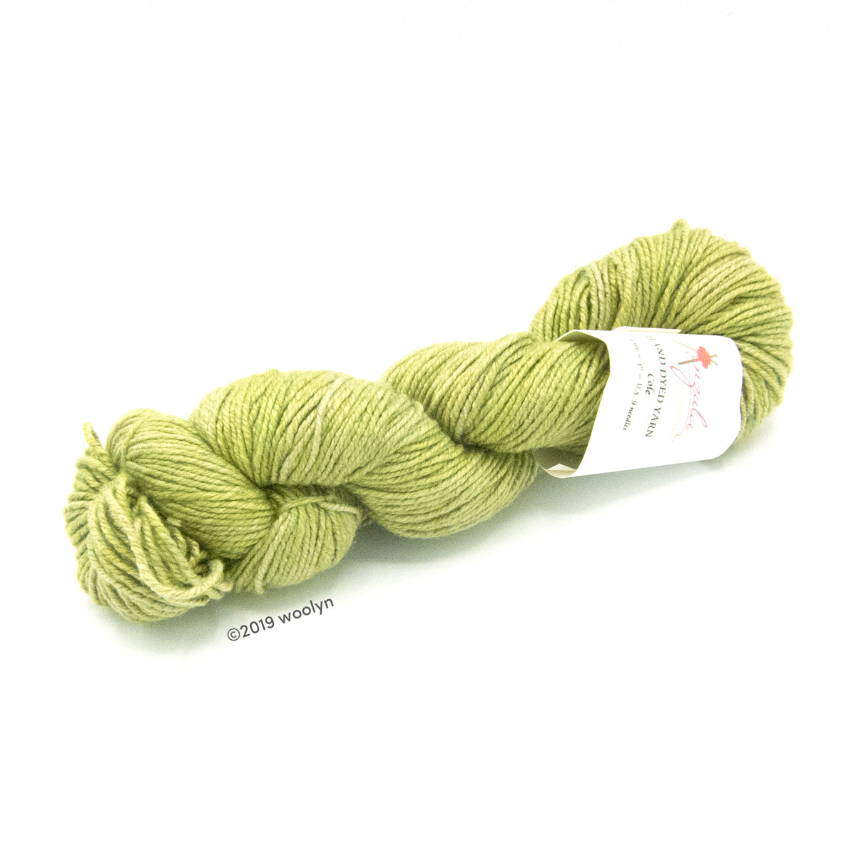 A twisted skein of Anzula Cole yarn in a bright yellow green.
