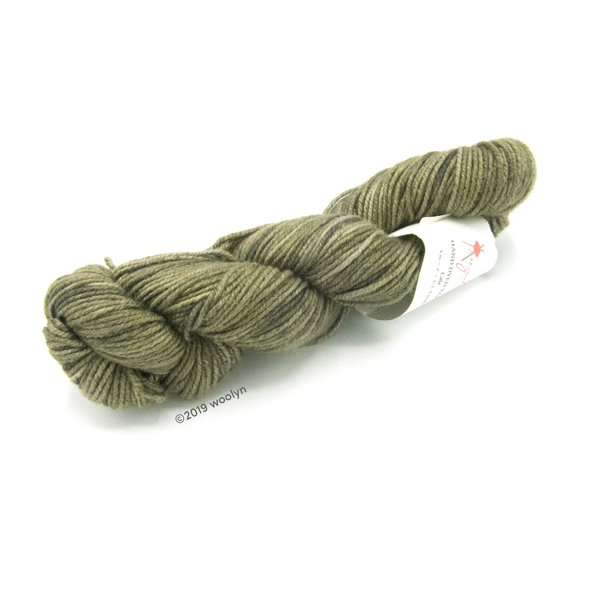 A twisted skein of Anzula Cole yarn in a dark green.