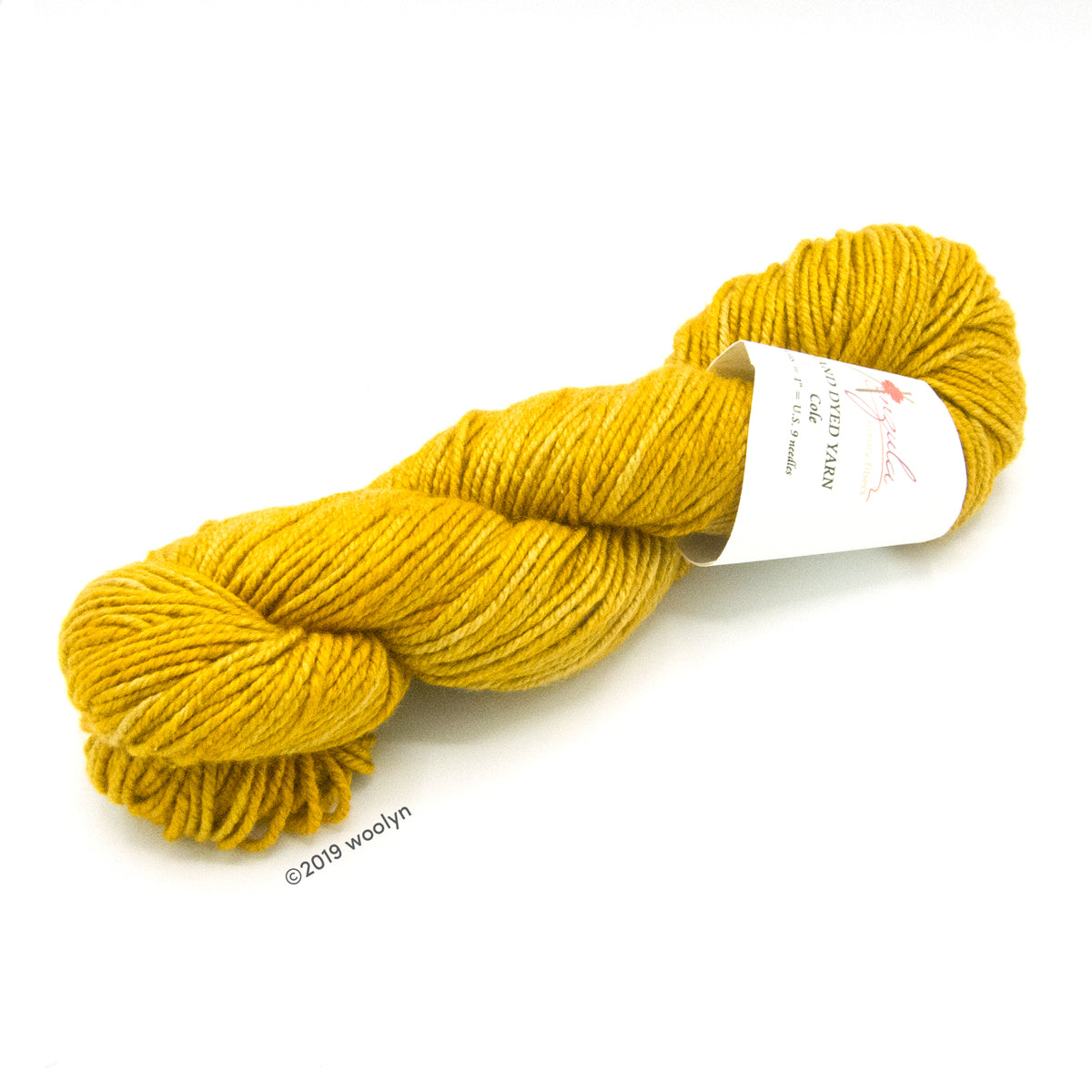 A twisted skein of Anzula Cole yarn in a warm yellow.