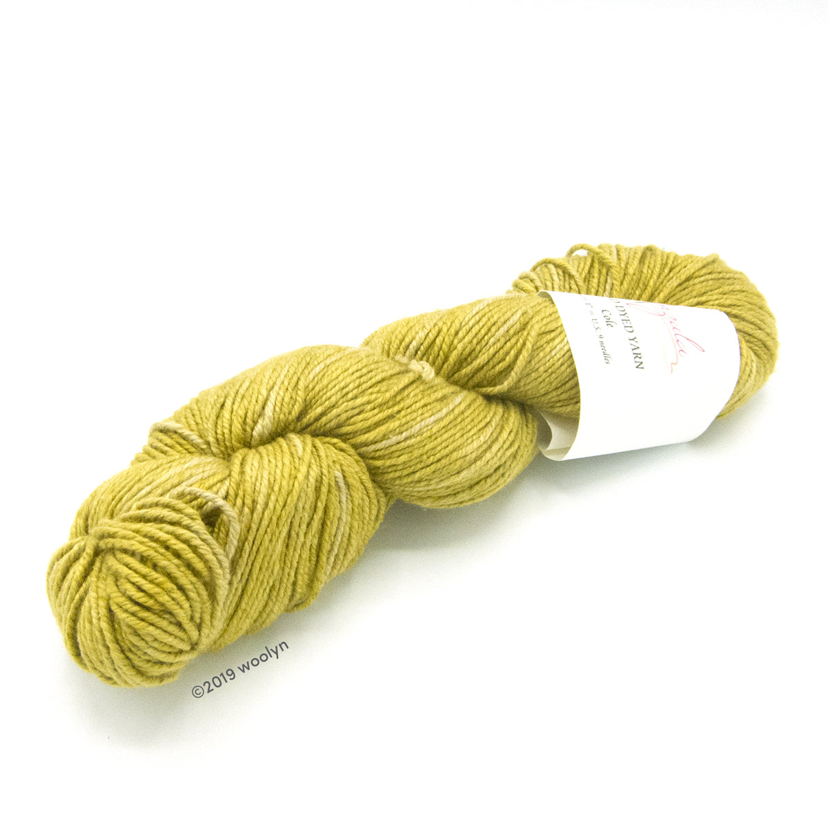 A twisted skein of Anzula Cole yarn in a bright yellow with green overtones.