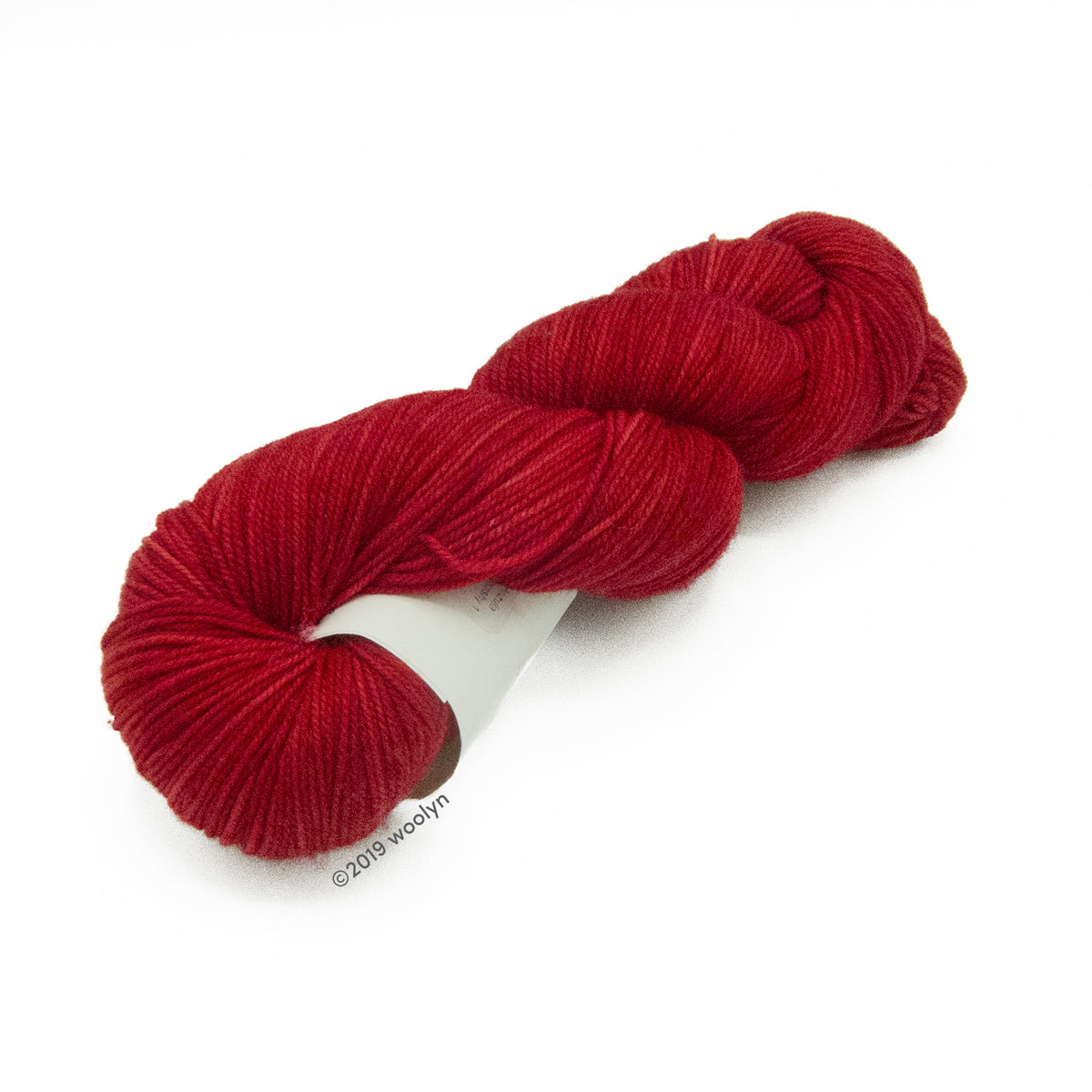 Hand dyed dark red yarn twisted into a skein.