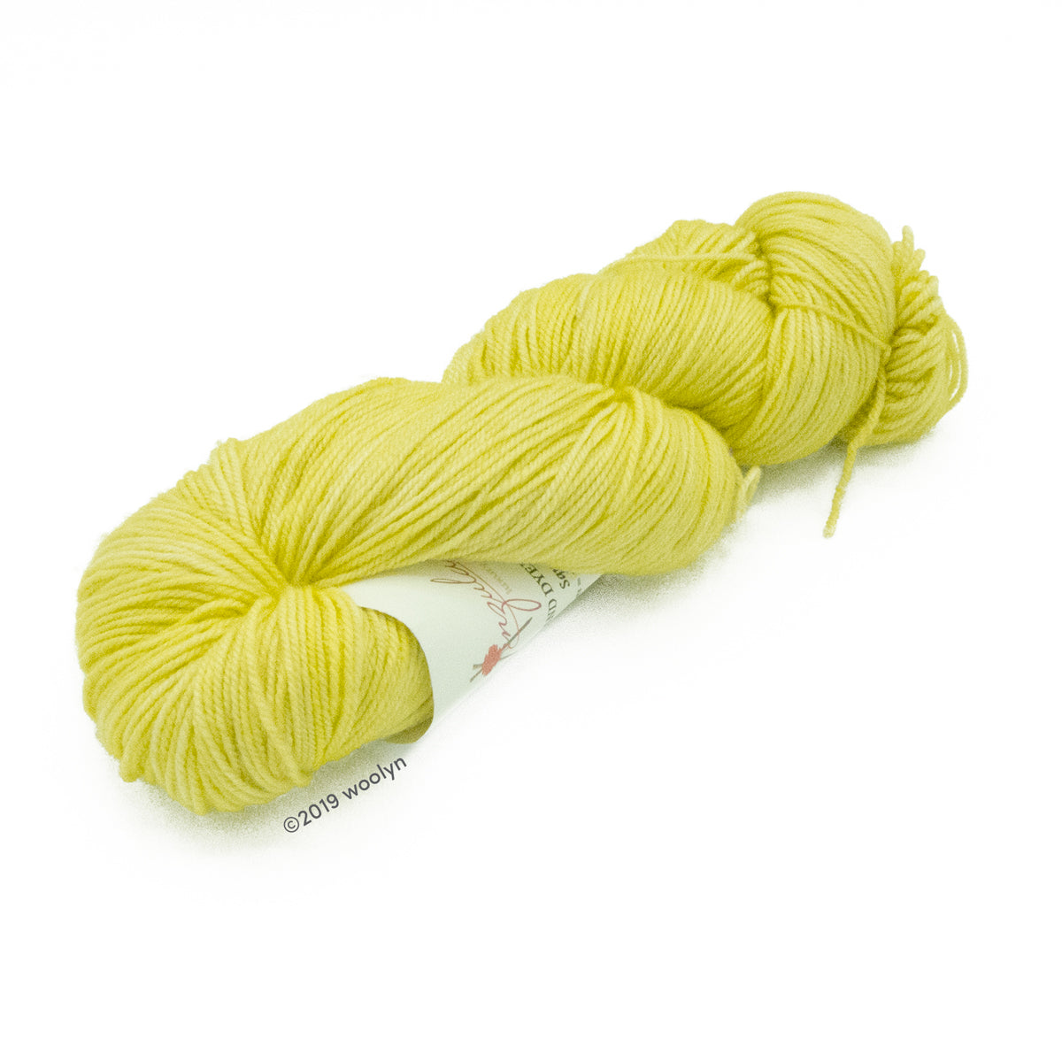 Hand dyed  fingering weight yarn in bright, light yellow tonal shades twisted into a skein.