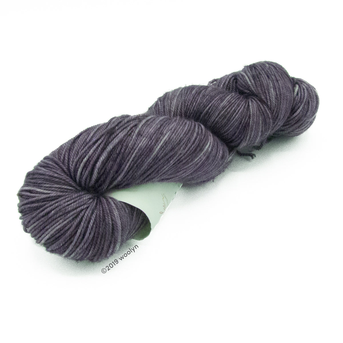 Hand dyed  fingering weight yarn in deep warm grey  tonal shades twisted into a skein.